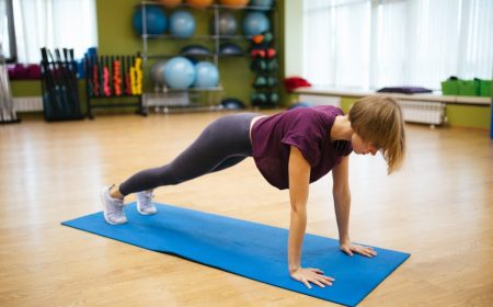 attractive-athlete-young-woman-doing-exercise-indoors_t20_6mo7g2